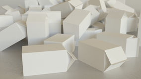 Mess of Blank Milk Cartons on Concrete Stock Photography