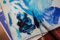 Mess of blue paints Stock Photos