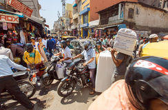 Mess on crossroad with crowd of busy people, motorbikes making traffic jam Royalty Free Stock Photography