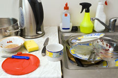 Mess in a kitchen. Some dirty dishes and kitchens' utensils in a terrible mess Royalty Free Stock Photography