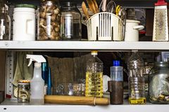 Mess in the kitchen on the shelf for kitchen utensils royalty free stock photo