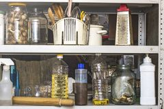 Mess in the kitchen on the shelf for kitchen utensils stock images