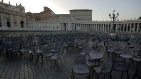 Mess in the main square of St. Peter's Basilica in Vatican City. Shot of numerous chairs messed in the square of St. Peter's Basilica in Vatican City stock video footage