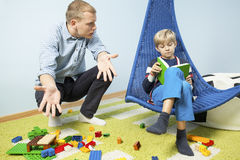 Mess in son room. Mad father because of mess in son room Royalty Free Stock Photo