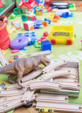 Mess of toys. Children's toys scattered in disarray on the carpet Stock Photos