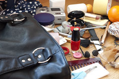 Mess in woman handbag. Mess disorder and accessories women concept Royalty Free Stock Image