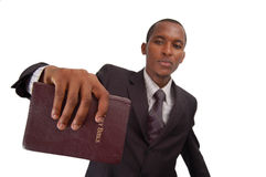The Message. This is an image of man holding a bible. This image can be used to represent sermon, preaching etc Royalty Free Stock Photo
