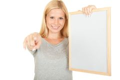 Message. Young attractive girl holding empty message board isolated on white stock photography