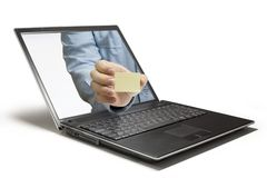 Message. Hands reaching out of a laptop Royalty Free Stock Photos