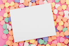 Message. Blank paper on candy heart background stock photo