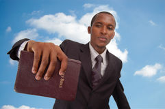 Message From Above. This is an image of man holding a bible. This image can be used to represent Heavenly message, sermon, preaching etc Stock Images