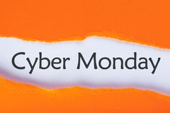 Message appearing behind ripped orange paper with Cyber Monday Sale text. Online shopping time. Day with biggest Sale stock image