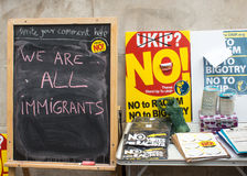 Message on blackboard at an Anti UKIP stall. Blackboard with message about immigration at an Anti UKIP and Farage stall Royalty Free Stock Images