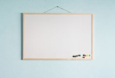 Message board. Hanging on a blue wall Stock Images
