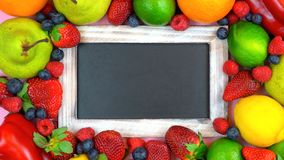 Message board blackboard surrounded by healthy food, royalty free stock photos