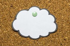 Message board with cloud shape paper pinned to cork Stock Photography