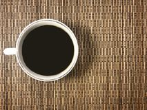 The message board with a cup of coffee on the wicker background. The message board with a cup of coffee on wicker background . On the side of the photo there is Stock Photo