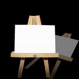 Message Board on Easel. Blank Canvas Message Board on A Wooden Easel isolated on Black Background with reflection.  Good to display messages of any kind Royalty Free Stock Image