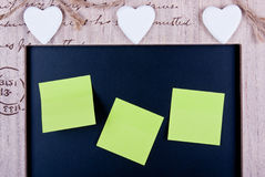 Message board. Notes posted on a message board decorated with hearts Royalty Free Stock Photography