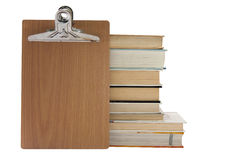 Message board with pile of books Stock Image