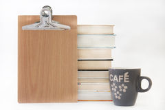 Message board with pile of books and coffe cup Stock Image