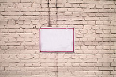 Message Board On White Brick Wall. A white message board on a white brick wall Royalty Free Stock Images
