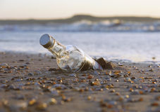 Message in a bottle. Lost message in a bottle stock photo