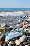 Message in a bottle. At the sea shore stock photo