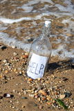 Message in a bottle. Washed up on a lost beach Royalty Free Stock Photos