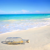 Message in a bottle. Washed ashore on the beach royalty free stock image