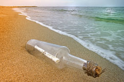 Message in a bottle. Still life about the message in a bottle on the beach Royalty Free Stock Photos