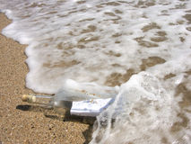 Message in the bottle. Washed ashore Royalty Free Stock Image