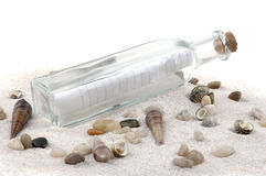 Message in a Bottle. Washed up on a beach Stock Photos