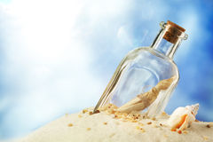 Message in a bottle. Against blue sky stock photo