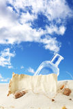Message in a bottle. Against blue sky stock image