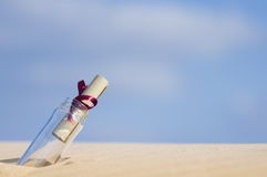 Message in a bottle. A bottle with a note inside it Stock Photos