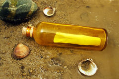 Message in a bottle. A message in a bottle washed up on the shore Stock Photo