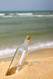 Message in bottle. Message in a bottle at beach stock photo