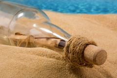 Message in a bottle. On the beach Stock Photos
