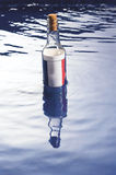 Message in a bottle. From France floating on the sea Stock Image