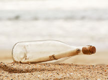 Message in a bottle. A Message in a bottle washed up on the beach, great business concept for snail mail, spam, or bad slow communication Royalty Free Stock Images
