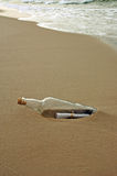 Message in a Bottle. Washed ashore during a sunset royalty free stock photo