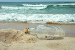 Message in a bottle. Washed on a distant shore stock photos