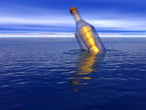 Message in a bottle. Floating on the sea Stock Photography