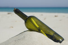 Message in a bottle. Old bottle with a message inside. Blue sea background. Beach scenic Stock Photography
