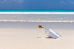 Message in a bottle 5. A message in a bottle on a white sand tropical beach Stock Photos