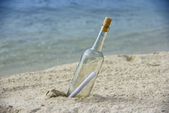 Message In Bottle. Message in a bottle on an isolated beach Royalty Free Stock Images