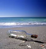 Message In A Bottle. On a tropical beach Royalty Free Stock Images