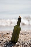 Message in the bottle. On empty coast Royalty Free Stock Photography