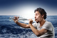 Message in the bottle. Young man with a message in a bottle Stock Images